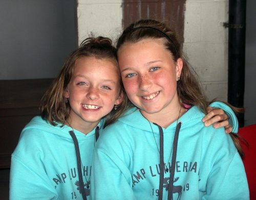 Two girls smiling wide