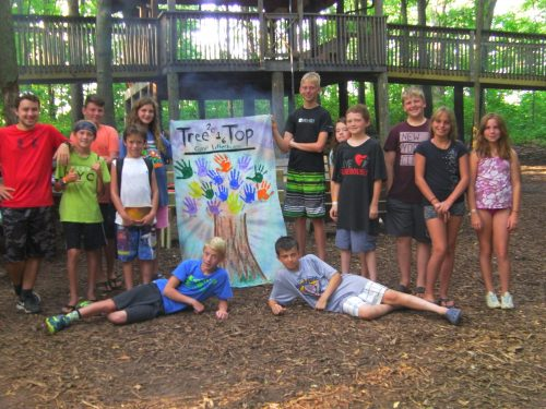 Treetop camper group with banner