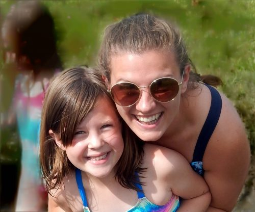 Girl camper & counselor with sunglasses closeup