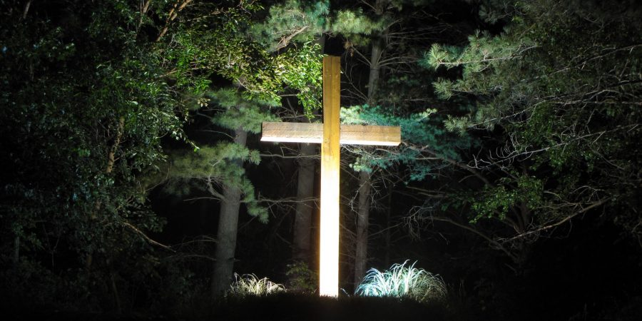 Cross on the hill lighted at night