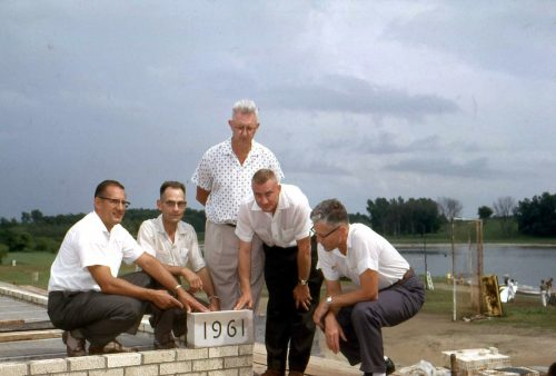 A few men placing the pavilion cornerstone in 1961