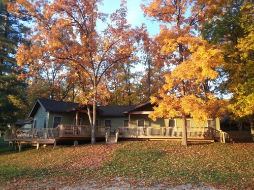 Front side of cabin with porches during autumn
