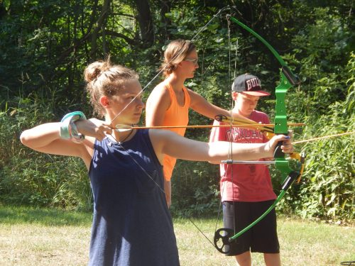 Girl taking aim at archery