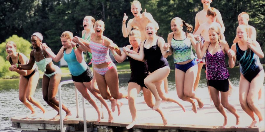 Cabin group jumping into the lake